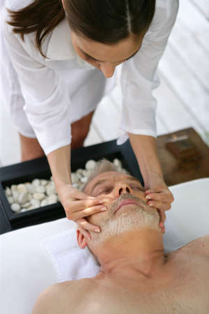 massaged: Man enjoying a face massage