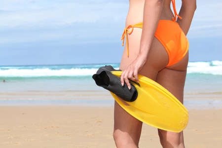 littoral: Woman on the beach with flippers Stock Photo