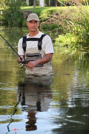 wading: Fisherman wading Stock Photo