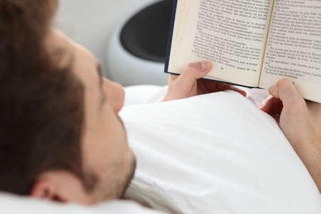 novel: young man reading a novel