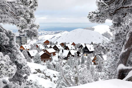 snow covered mountain: Snow covered chalets Stock Photo