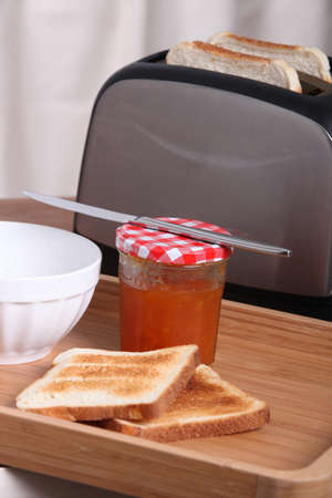 Toaster with jam and toasted bread photo