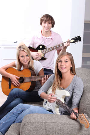 Teen playing guitar photo
