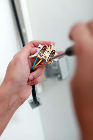 operating key: Female hands with electrical pieces