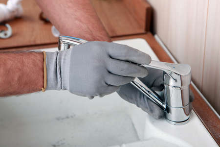 Plumber fixing a sink Stock Photo - 22507077