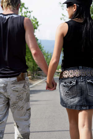 Couple walking hand in hand photo