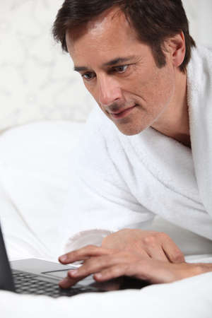 Man working in dressing gown  photo