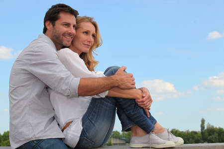 affinity: Couple sitting on curb Stock Photo