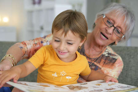 Grandmother reading with toddler photo