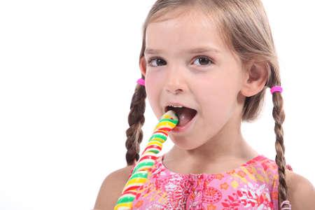 Girl eating lollipop Stock Photo