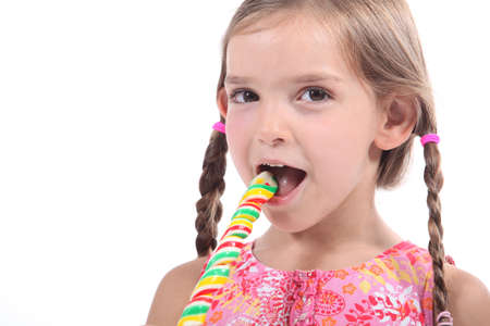 Girl eating lollipop Foto de archivo