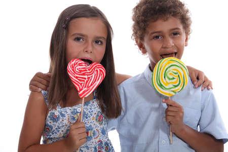 Children with lollipops photo