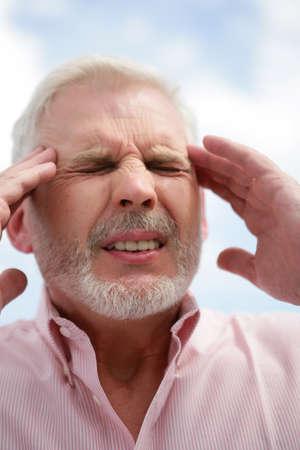 55 60 years: Senior man with a headache