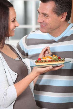 married couple eating tart photo