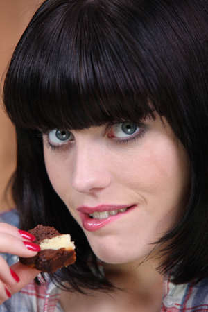 Woman eating piece of cake photo