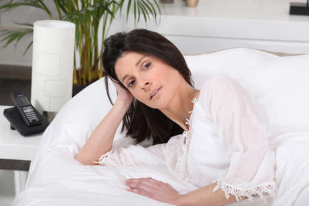 everyday people: Woman lying in bed