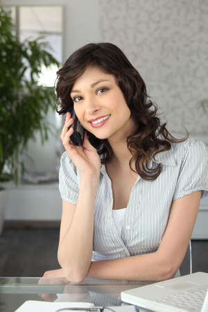 a brunette woman at phone photo