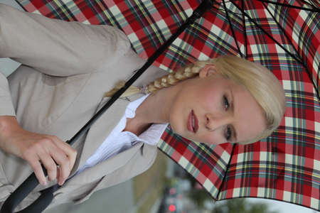 Blond woman with tartan umbrella photo