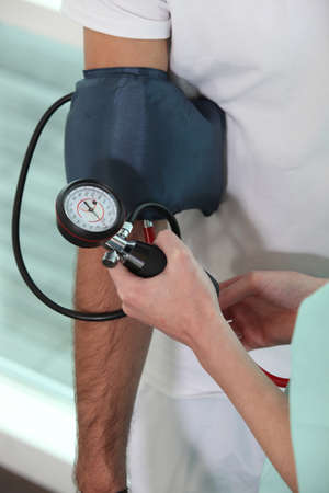 Nurse taking blood pressure photo