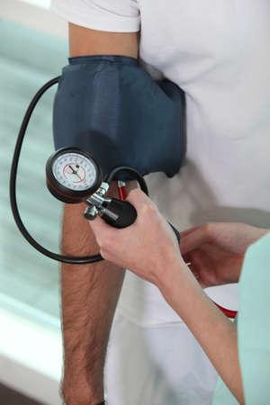 blood pressure bulb: Nurse taking blood pressure