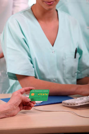 reparations: Nurse taking social security details Stock Photo