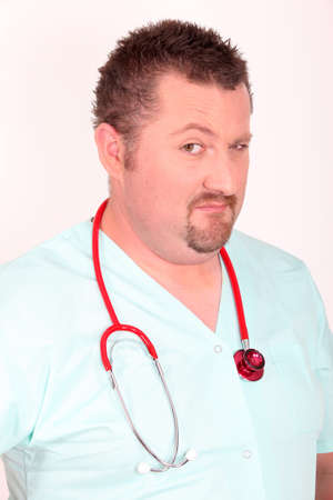 eyebrow raised: Doctor with raised eyebrow Stock Photo