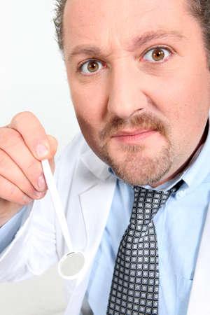 circumspect: Dentist with Instrument