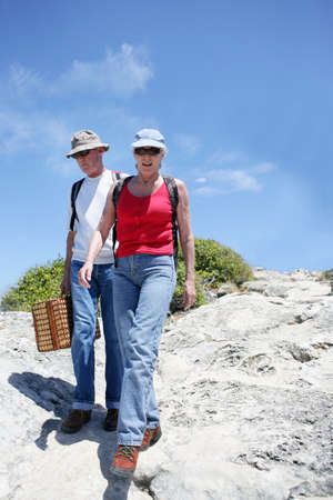 Senior couple about to have coastal picnic photo