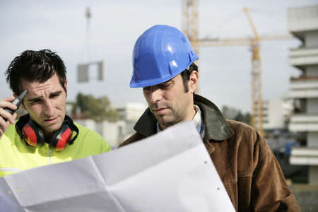 Foreman and colleagues examining building plans