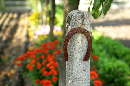 horse stable: Horse shoe attached to stone post Stock Photo