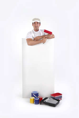 leaned: Decorator posing by a poster Stock Photo