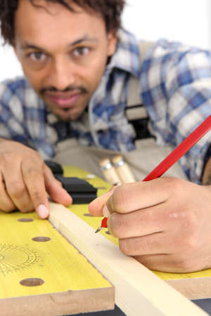Carpenter marking wood photo