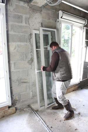 double glazing: Worker installing new windows