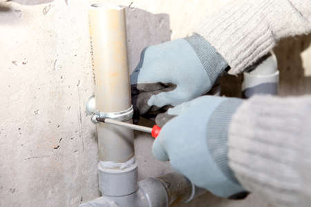 fixer: Plumber installing pipes Stock Photo