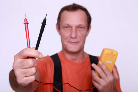 voltmeter: Electrician with voltmeter Stock Photo
