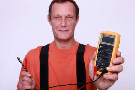 wireman: Man holding voltmeter