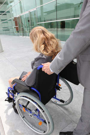 help handicapped woman on wheelchair Stock Photo