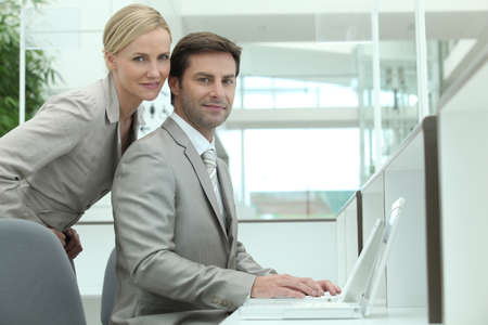Business couple using a laptop computer photo