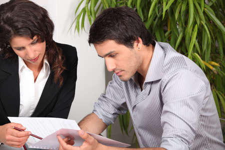 legal services: Couple reading through a report