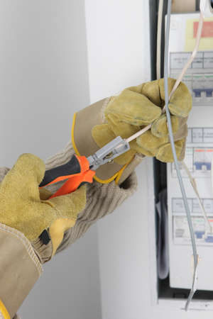 Electrician using wire strippers photo