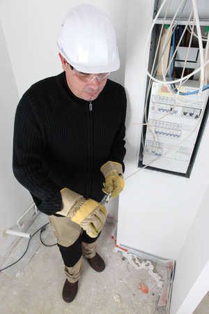 fuse box: electrician working on the  fuse box Stock Photo