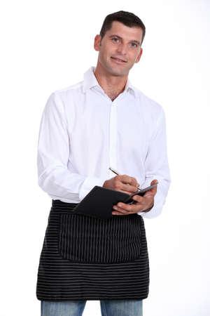 proprietor: Casual waiter taking an order Stock Photo