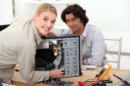 Technician fixing a computer photo