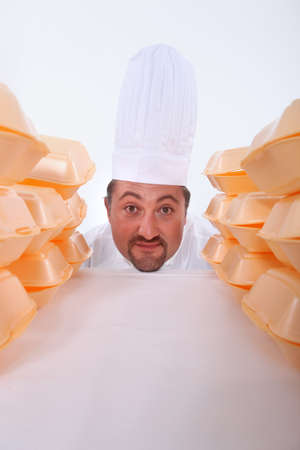 clowning: Chef with fast-food packaging