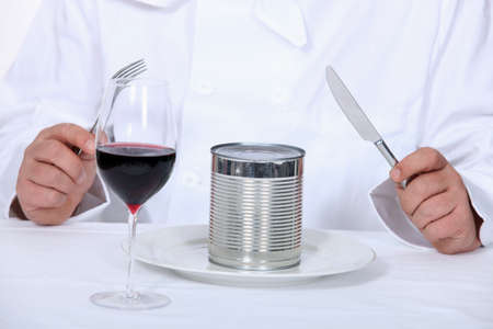 canned goods: Chef sitting down to a canned dinner