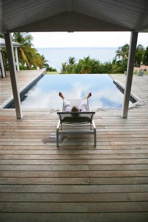 Man sat by hotel pool