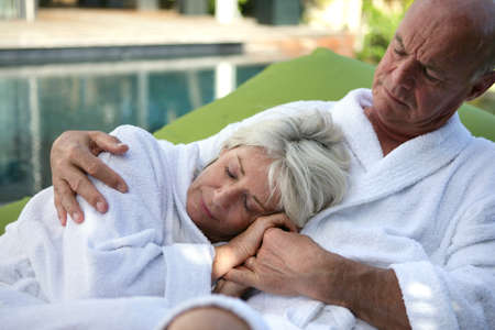 senior couple relaxing by the pool photo