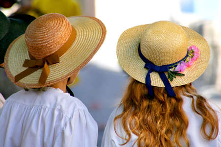 Two women wearing straw hats photo
