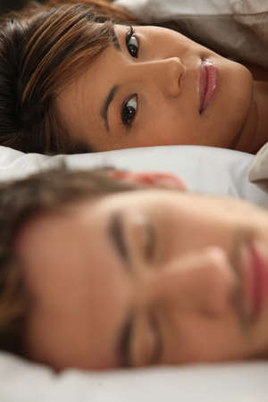 close-up shot of young couple in bed photo