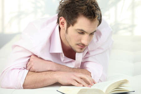 young man reading a book photo